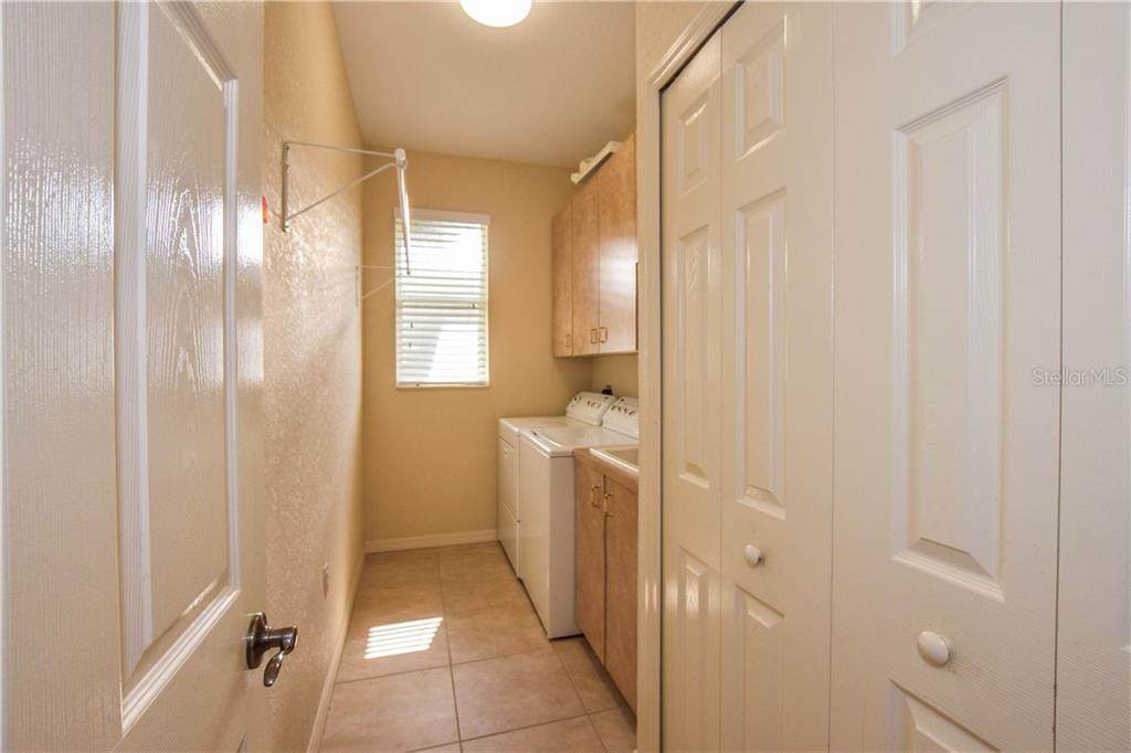 Laundry room. - Single Family Home for sale at 2560 Pebble Creek Pl, Port Charlotte, FL 33948 - MLS Number is N6109100