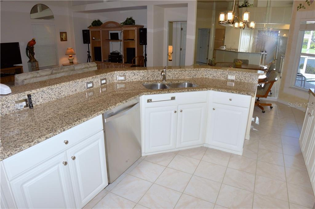 Kitchen to great room and breakfast nook - Single Family Home for sale at 413 Pebble Creek Ct, Venice, FL 34285 - MLS Number is N6110166