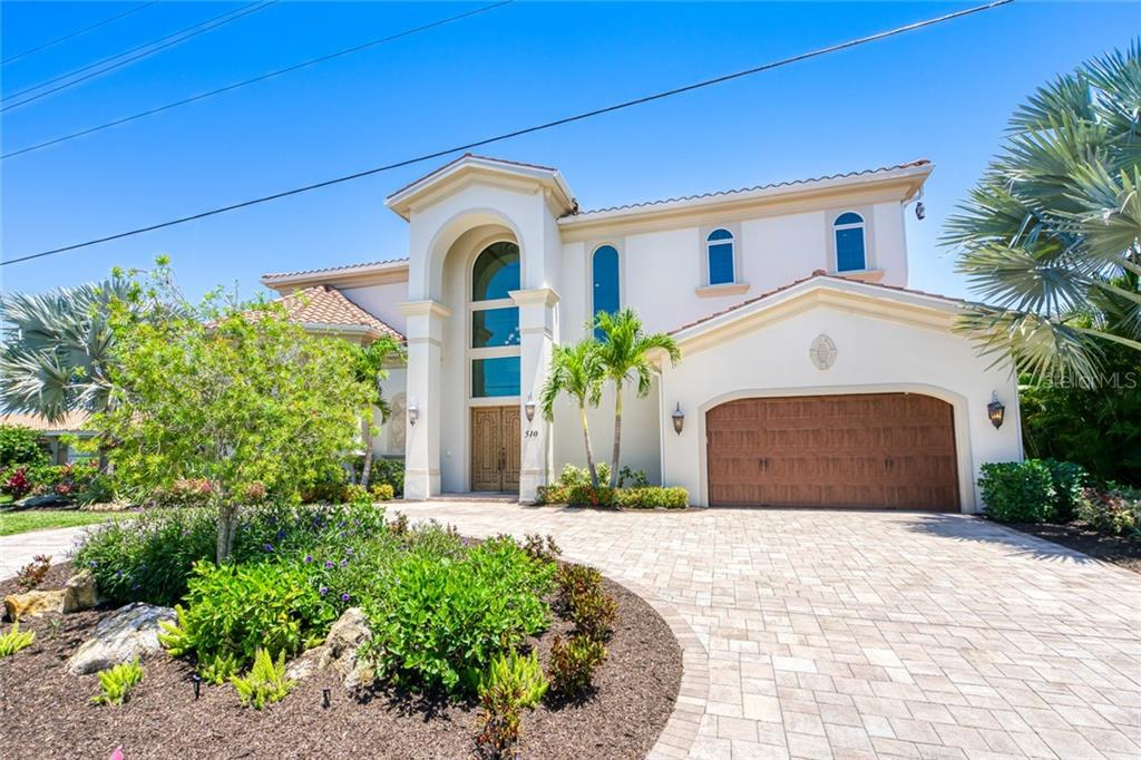 Circular Driveway with pavers . Freshly painted Exterior 5/2020 - Single Family Home for sale at 510 Bowsprit Ln, Longboat Key, FL 34228 - MLS Number is N6110334