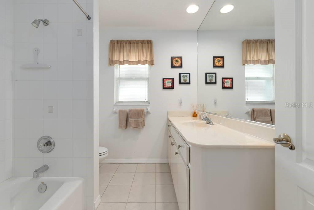 Guest bathroom - Single Family Home for sale at 498 Pine Lily Way, Venice, FL 34293 - MLS Number is N6110849