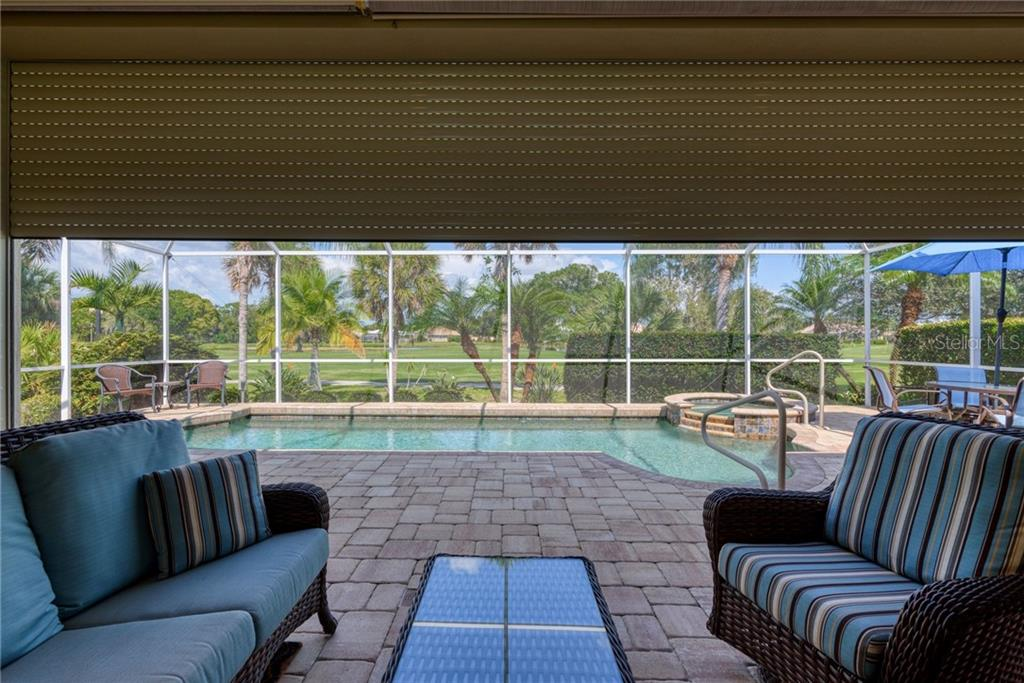Lanai with electronic hurricane protection on lanai - Single Family Home for sale at 953 Chickadee Dr, Venice, FL 34285 - MLS Number is N6111180