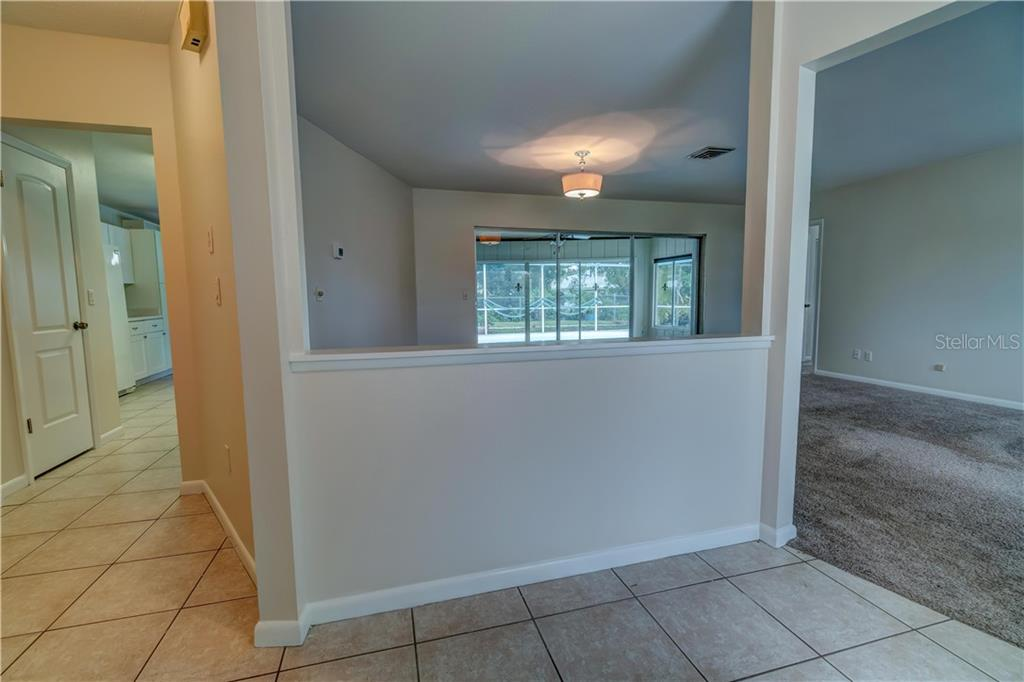 Entry Foyer - Single Family Home for sale at 158 Golf Club Ln, Venice, FL 34293 - MLS Number is N6111200