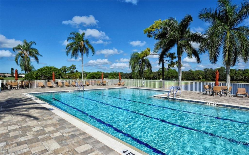 Clubhouse heated pool - Single Family Home for sale at 601 Cockatoo Cir, Venice, FL 34285 - MLS Number is N6111658