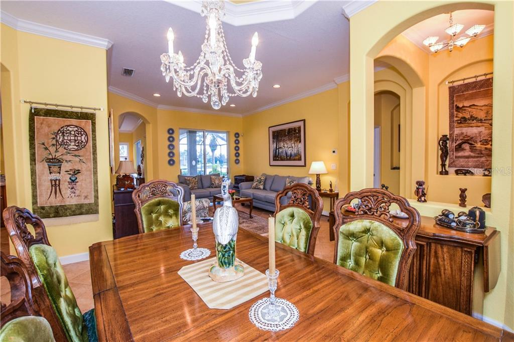 Dining room to living room - Single Family Home for sale at 154 Rimini Way, North Venice, FL 34275 - MLS Number is N6112459