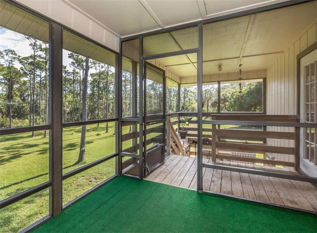 Entry, screened porch - Single Family Home for sale at 9425 Myakka Dr, Venice, FL 34293 - MLS Number is N6112567