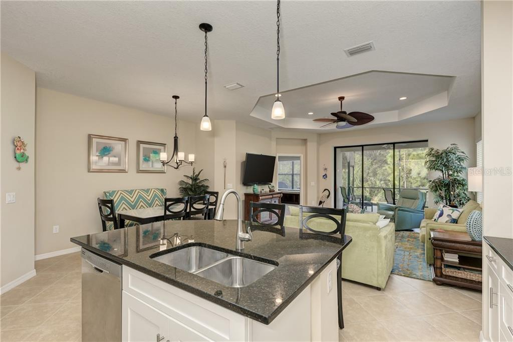Kitchen Island - Villa for sale at 11433 Okaloosa Dr, Venice, FL 34293 - MLS Number is N6113314
