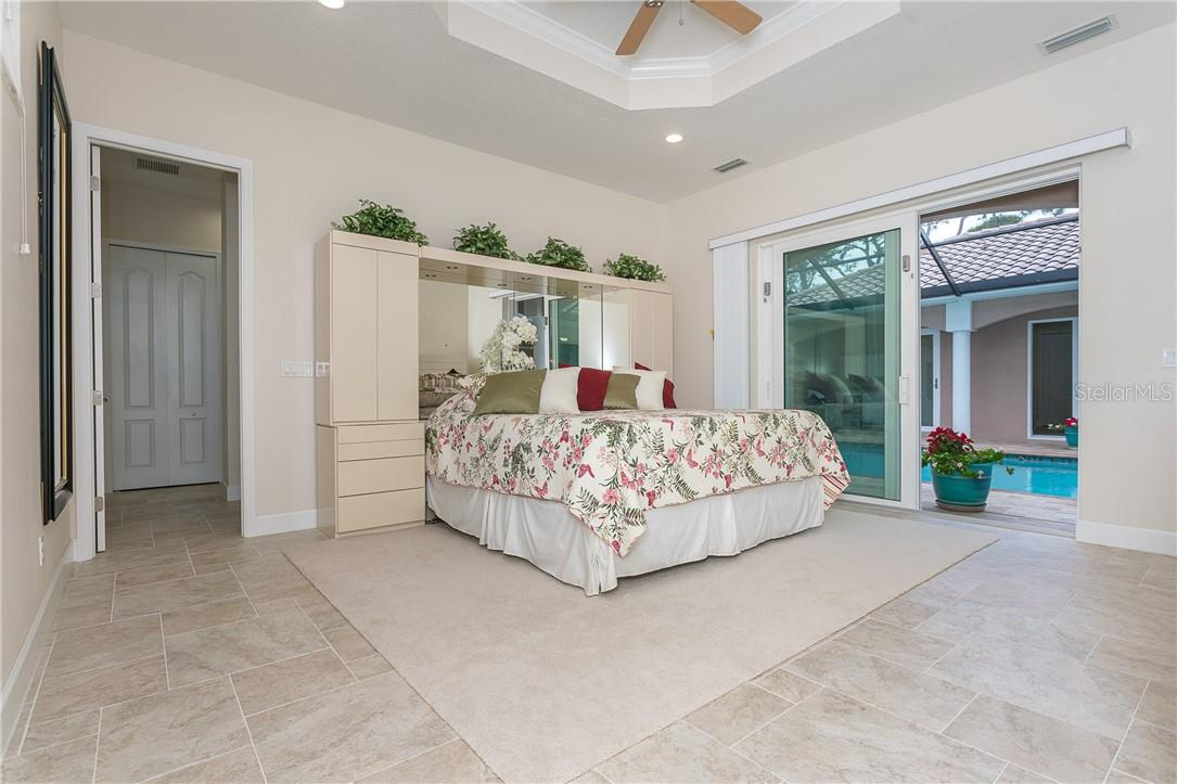 Owner's suite, with two walk-in closets plus a linen closet beyond. - Single Family Home for sale at 1670 Maria St, Englewood, FL 34223 - MLS Number is N6113779