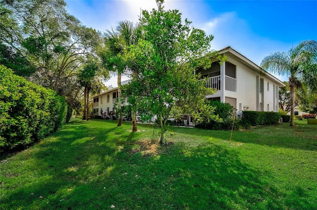 Rear exterior - Condo for sale at 1041 Capri Isles Blvd #105, Venice, FL 34292 - MLS Number is N6114557
