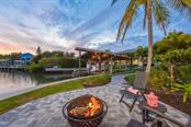 Fire Pit & Boathouse - Single Family Home for sale at 525 Bayview Pkwy, Nokomis, FL 34275 - MLS Number is N5912985