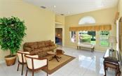 Family Room to Study - Single Family Home for sale at 886 Macaw Cir, Venice, FL 34285 - MLS Number is N5913009