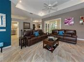 Living room to kitchen - Single Family Home for sale at 530 Waterwood Ln, Venice, FL 34293 - MLS Number is N5914538