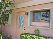 Storm shutters for windows - Villa for sale at 132 Inlets Blvd #132, Nokomis, FL 34275 - MLS Number is N5914693
