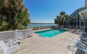 Expansive deck and pool overlooking the bay. - Single Family Home for sale at 3509 Casey Key Rd, Nokomis, FL 34275 - MLS Number is N5915098