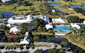 Aerial view of Plantation Golf and Country Club - Condo for sale at 1036 Wexford Blvd #1036, Venice, FL 34293 - MLS Number is N5915474