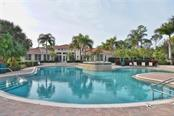 Community pool/clubhouse - Single Family Home for sale at 769 Sawgrass Bridge Rd, Venice, FL 34292 - MLS Number is N5916484