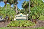 Community sign - Condo for sale at 703 Bird Bay Cir #114, Venice, FL 34285 - MLS Number is N6100166