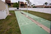 Shuffle board - Condo for sale at 519 Albee Farm Rd #117, Venice, FL 34285 - MLS Number is N6100461