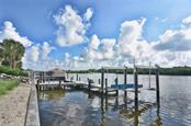 Shared dock - Single Family Home for sale at 616 S Casey Key Rd, Nokomis, FL 34275 - MLS Number is N6100721