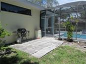 Large BBQ Patio off lanai - Single Family Home for sale at 2405 Uppakrik Ln, Nokomis, FL 34275 - MLS Number is N6100812