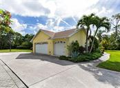 Large 3-car side load garage with plenty of space for guest parking or to park your RV or boat. - Single Family Home for sale at 620 Valencia Rd, Venice, FL 34285 - MLS Number is N6100912