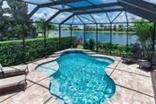 Pool with sunbathing shelf and waterfall - Single Family Home for sale at 368 Marsh Creek Rd, Venice, FL 34292 - MLS Number is N6101204