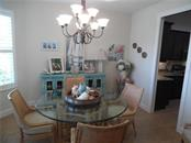dining room opens to the kitchen - Single Family Home for sale at 239 Nolen Dr, Venice, FL 34292 - MLS Number is N6101457