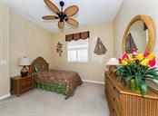 Bedroom 2 - Single Family Home for sale at 691 Lakescene Dr, Venice, FL 34293 - MLS Number is N6101920