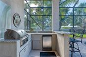 Outdoor kitchen - Single Family Home for sale at 633 Apalachicola Rd, Venice, FL 34285 - MLS Number is N6102111