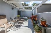 You won't want to leave the front terrace, a perfect place to relax and entertain! - Villa for sale at 206 Cerromar Way S #25, Venice, FL 34293 - MLS Number is N6102127