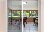 Sliders to Florida room - Single Family Home for sale at 717 Guild Dr, Venice, FL 34285 - MLS Number is N6103134