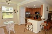 Breakfast nook, breakfast bar, kitchen - Condo for sale at 20140 Ragazza Cir #102, Venice, FL 34293 - MLS Number is N6103394