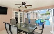 Lanai to pool - Single Family Home for sale at 1460 Strada D Argento, Venice, FL 34292 - MLS Number is N6104612