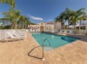 Community pool and clubhouse - Condo for sale at 806 Ravinia Cir #806, Venice, FL 34292 - MLS Number is N6106331
