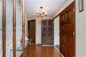 Carved doors open to tiled foyer - Single Family Home for sale at 359 Renoir Dr, Osprey, FL 34229 - MLS Number is N6106429