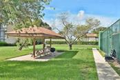 Picnic area - Condo for sale at 626 Bird Bay Dr S #104, Venice, FL 34285 - MLS Number is N6107935