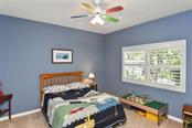 Bedroom 2 - Single Family Home for sale at 7185 N Serenoa Dr, Sarasota, FL 34241 - MLS Number is N6109058