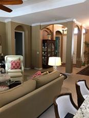 Great room to foyer - Single Family Home for sale at 19694 Cobblestone Cir, Venice, FL 34292 - MLS Number is N6109367