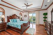 #4 master suite on second floor with walk-on balcony over looking the water and pool - Single Family Home for sale at 510 Bowsprit Ln, Longboat Key, FL 34228 - MLS Number is N6110334