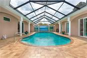 The private, 18x38 saltwater pool awaits. - Single Family Home for sale at 1670 Maria St, Englewood, FL 34223 - MLS Number is N6113779