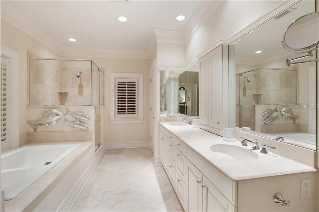 Master bath with travertine floors and counters, soaking tub and separate shower - Single Family Home for sale at 1600 E Railroad Ave, Boca Grande, FL 33921 - MLS Number is D6108744