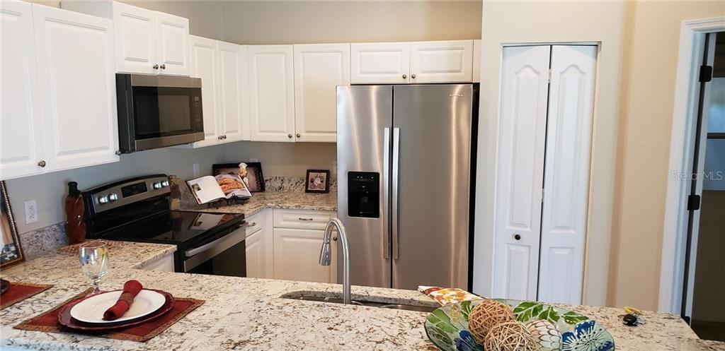 Breakfast Bar - Single Family Home for sale at 4945 79th St E, Bradenton, FL 34203 - MLS Number is T3163646