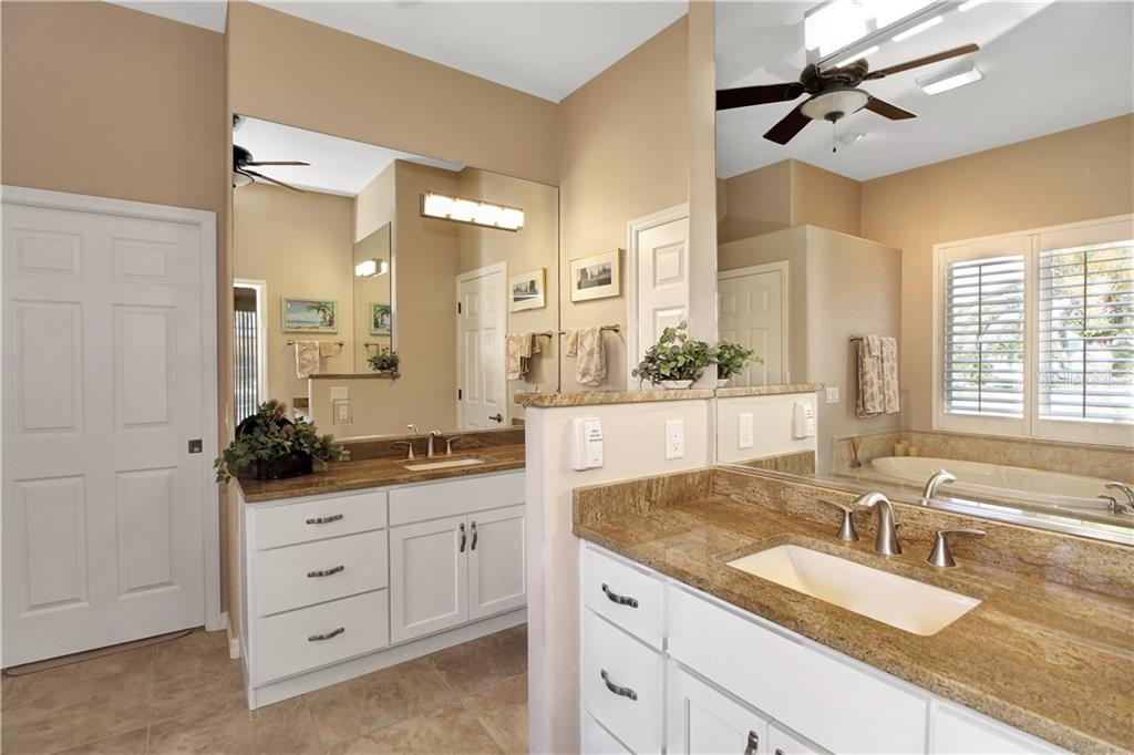 The Master Bath includes his and hers vanities, walk-in closet, enclosed water closet and extra large storage/linen closet. - Single Family Home for sale at 1201 San Mateo Dr, Punta Gorda, FL 33950 - MLS Number is U8037798