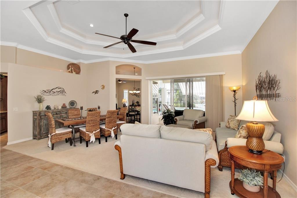 From the entry, the open floor plan takes you to the Living Room, Dinning area and view to the lanai. - Single Family Home for sale at 1201 San Mateo Dr, Punta Gorda, FL 33950 - MLS Number is U8037798