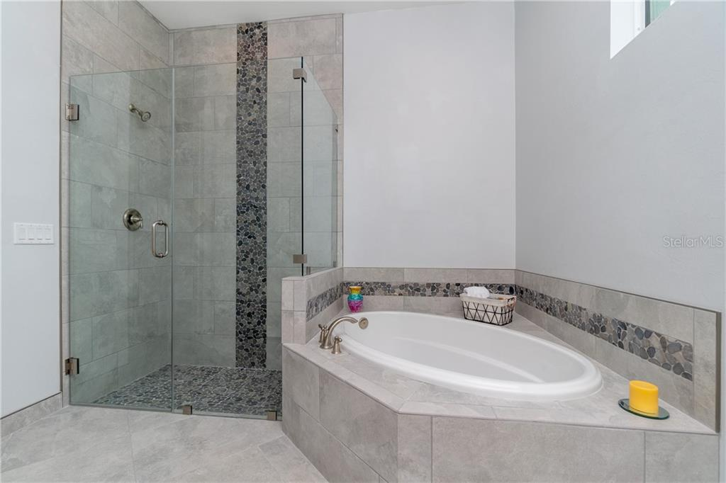 Master bath with beautiful tile details - Single Family Home for sale at 3302 Palm Dr, Punta Gorda, FL 33950 - MLS Number is C7247251
