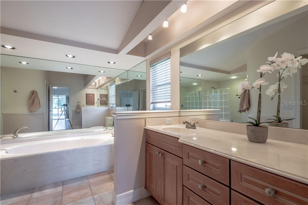 The Master Bath Has Dual Sinks With A Large Vanity. A Jetted Tub And A