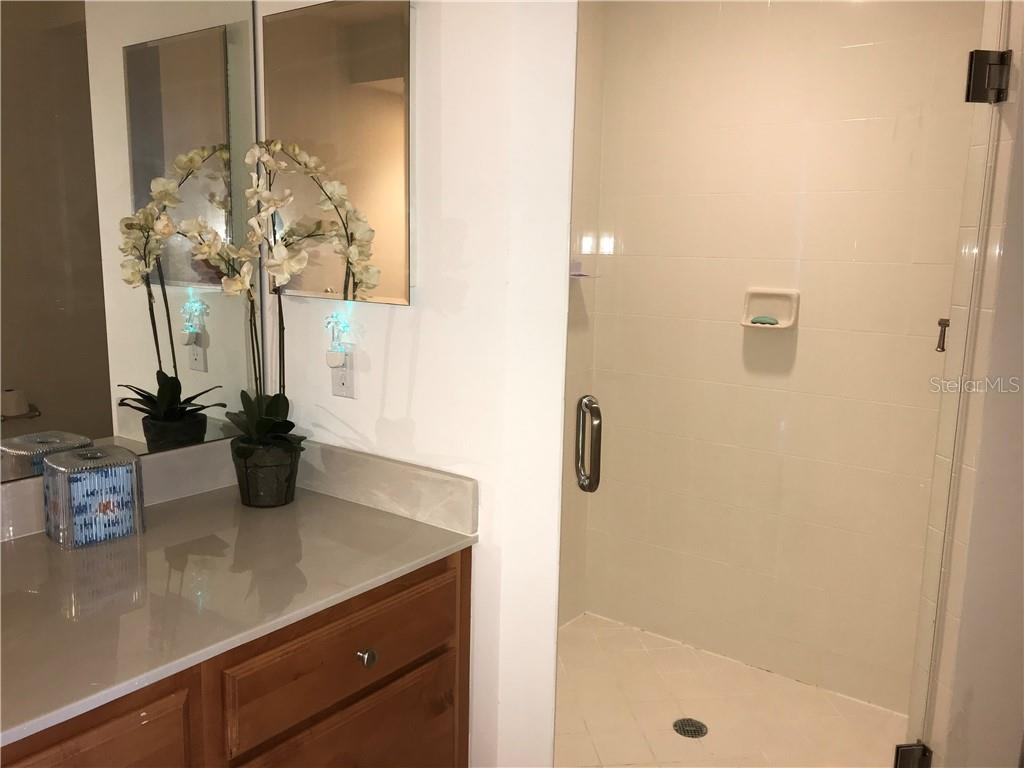 Master bath with walk in shower - Condo for sale at 3333 Sunset Key Cir #202, Punta Gorda, FL 33955 - MLS Number is C7410701
