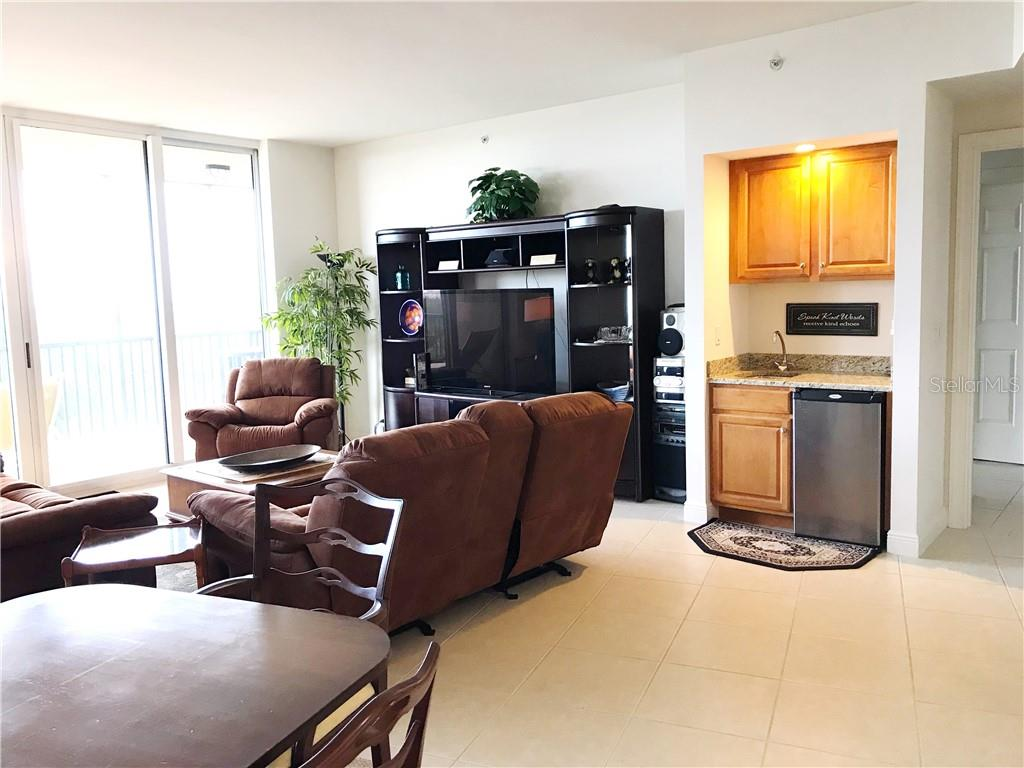 Wet bar, beverage refrigerator, sink and cabinetry - Condo for sale at 3333 Sunset Key Cir #202, Punta Gorda, FL 33955 - MLS Number is C7410701