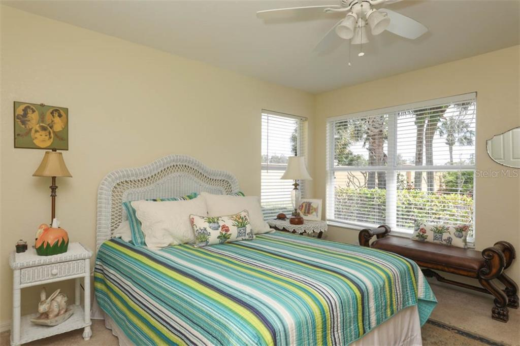Bright & cheerful 2nd bedroom is situated in the rear of the home and conveniently situated next to the 2nd bath. - Single Family Home for sale at 24620 Dolphin Cove Dr, Punta Gorda, FL 33955 - MLS Number is C7413467