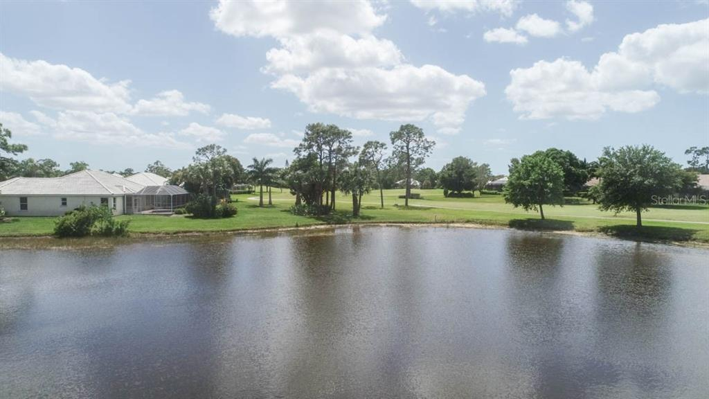 Just imagine the wildlife that gathers in and around this little body of fresh water. - Single Family Home for sale at 24620 Dolphin Cove Dr, Punta Gorda, FL 33955 - MLS Number is C7413467