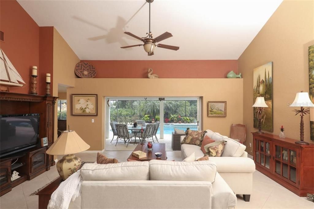 Sliding glass doors provide access to the covered lanai and pool area allowing you to open the house up to tropical breezes and plenty of fresh air! - Single Family Home for sale at 24620 Dolphin Cove Dr, Punta Gorda, FL 33955 - MLS Number is C7413467